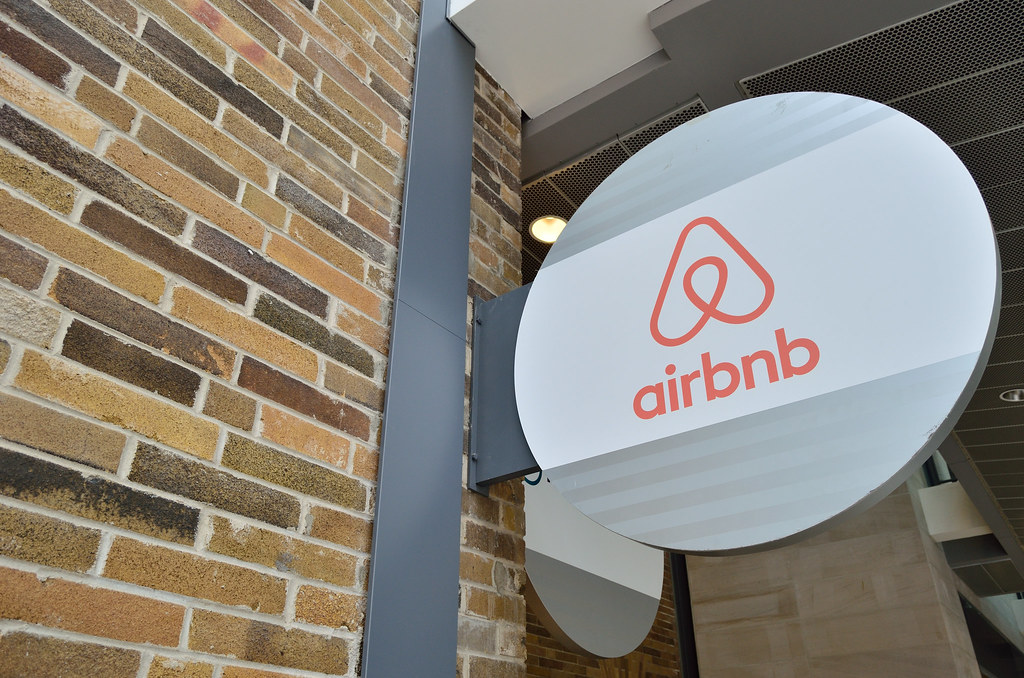 image of airbnb's logo on a brick facade